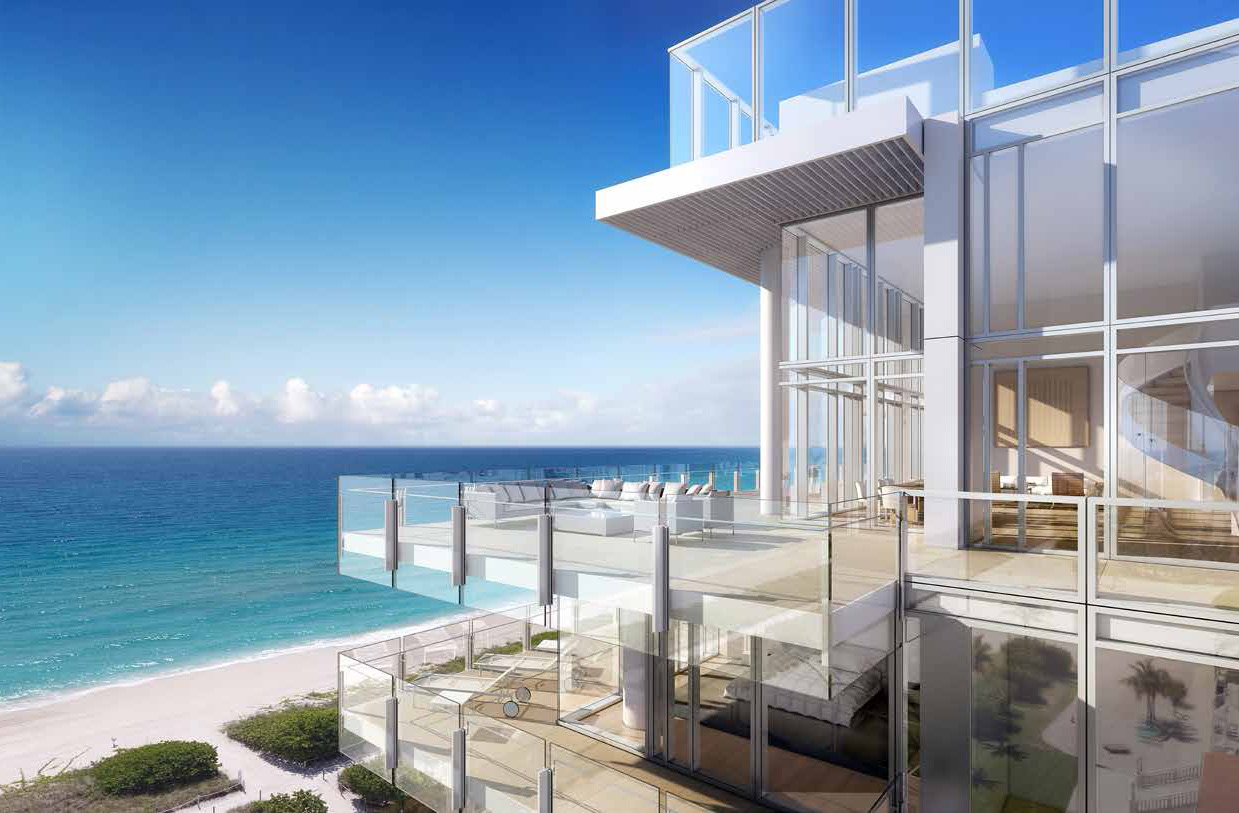 view of surf club condo with large outdoor patio with glass walls and railings