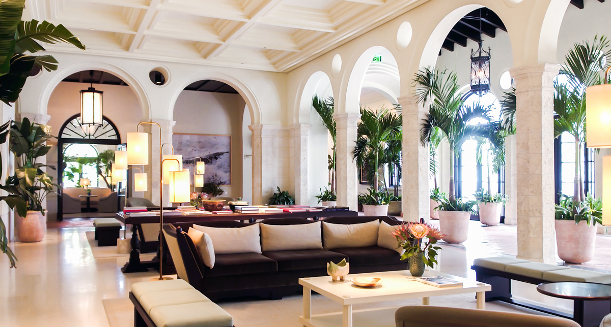 large room with stunning arches plants and couches