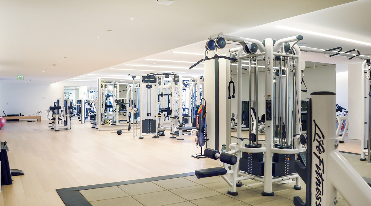 fitness center with multiple new machines at the Surf Club Four Seasons