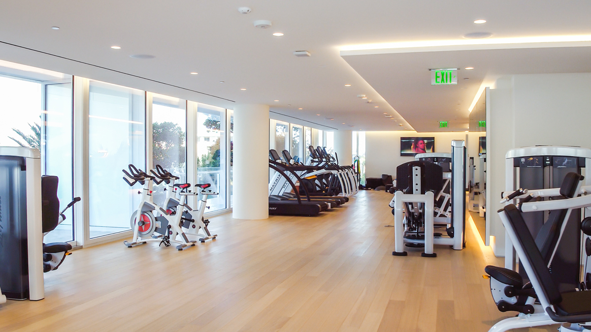 fitness center with workout machines at the Surf Club Four Seasons