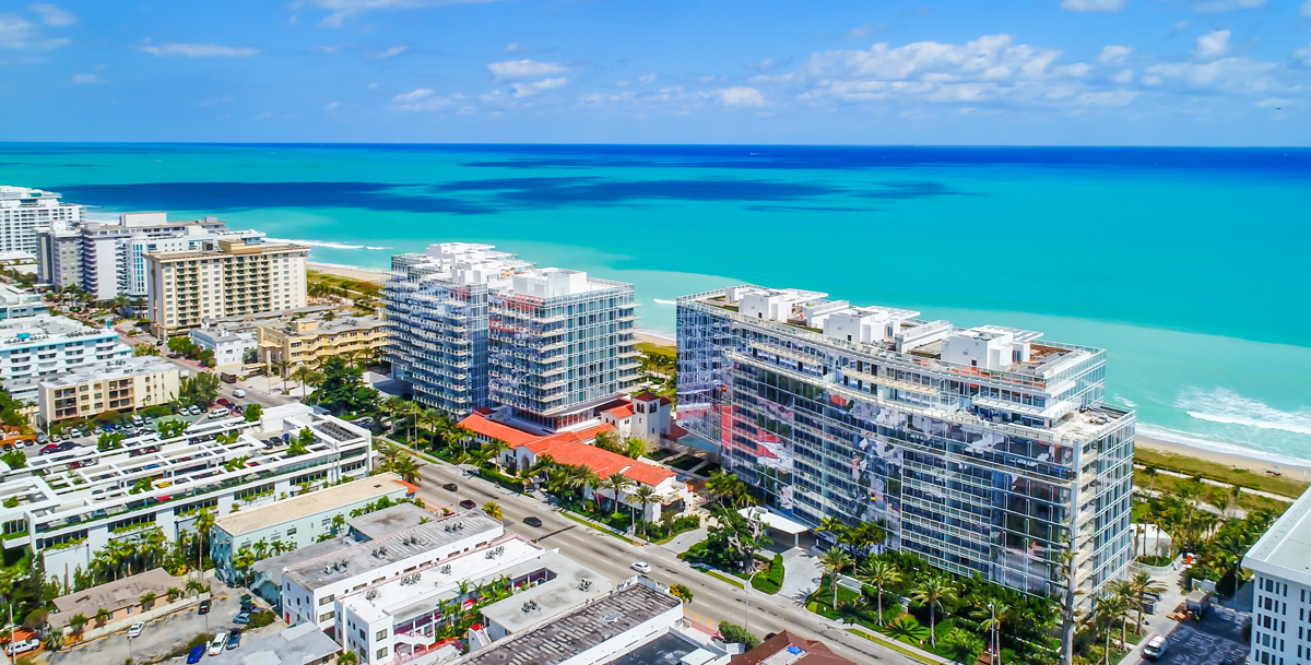 aerial view from behind the Surf Club Four Seasons with views of surrounding buildings