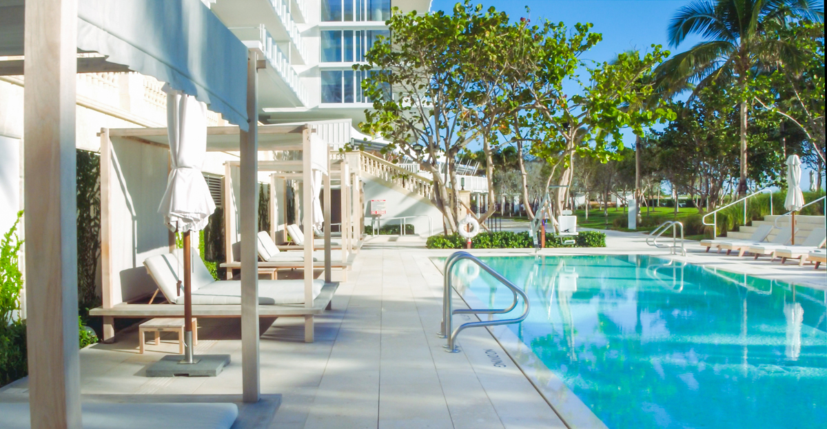 poolside view of outdoor swimming pool at the Surf Club Four Seasons residences