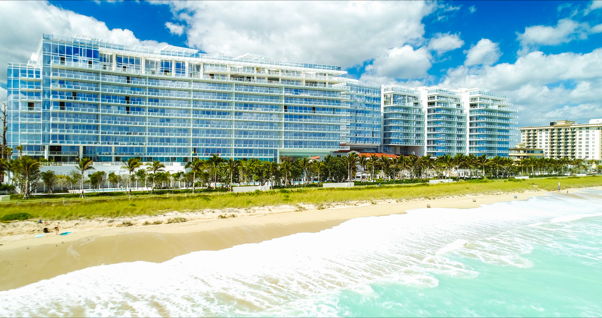 aerial views large of towers with all glass exteriors at the surf club four seasons