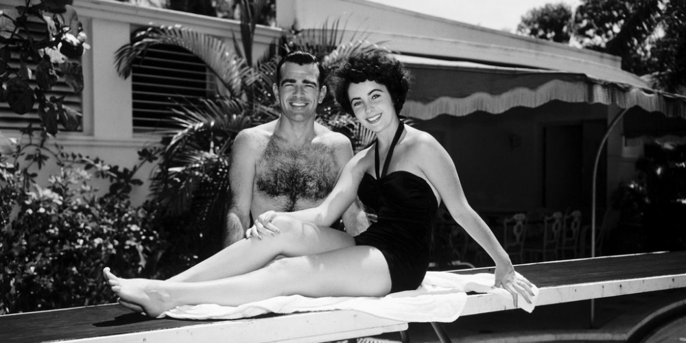 A black and white photo of Elizabeth Taylor in a swimsuit at the Surf Club.