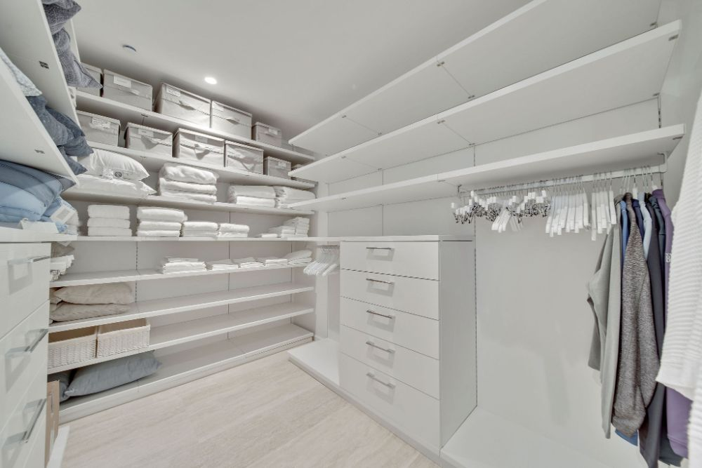 A large walk in closet inside the residences at the Surf Club
