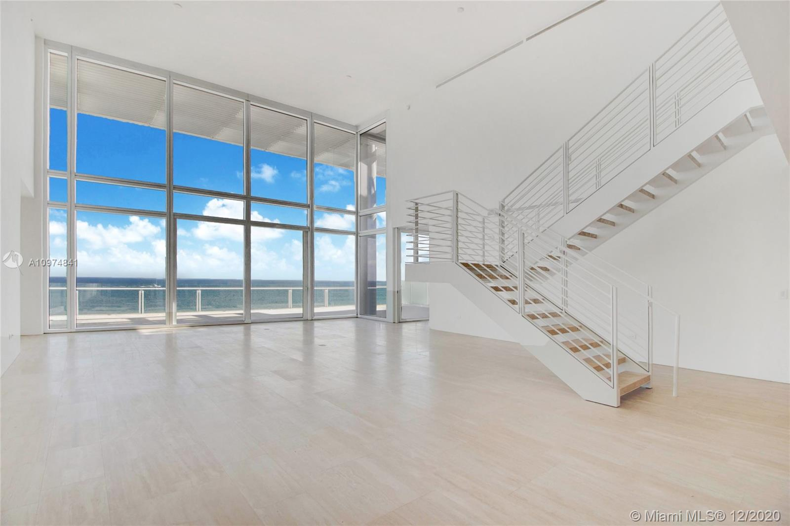 view from within S-PH2 Penthouse condo with large open white room with stunning view of Miami beach